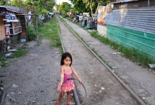Living on the railway, a girl and her hula hoop – photo by Renata Blonska