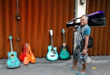 Guitar seller, streets of Manila, PHILIPPINES – photo by Renata Blonska