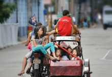11 travelers and one tricycle, popular way of transportation in Philippines – photo by Renata Blonska
