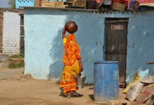 A woman carrying milk - daily life in Abhaneri village - photo by Renata Blonska